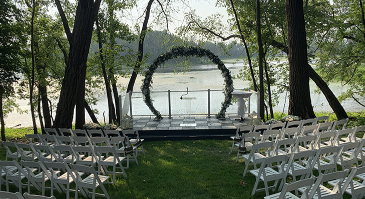 Serenity Hall at Celebrations on the River. Outdoor ceremony altar for wedding. Wedding altar outdoors in La Crosse, WI. Riverside ceremony altar for wedding in Wisconsin. Small riverside ceremony altar for outdoor wedding ceremony.